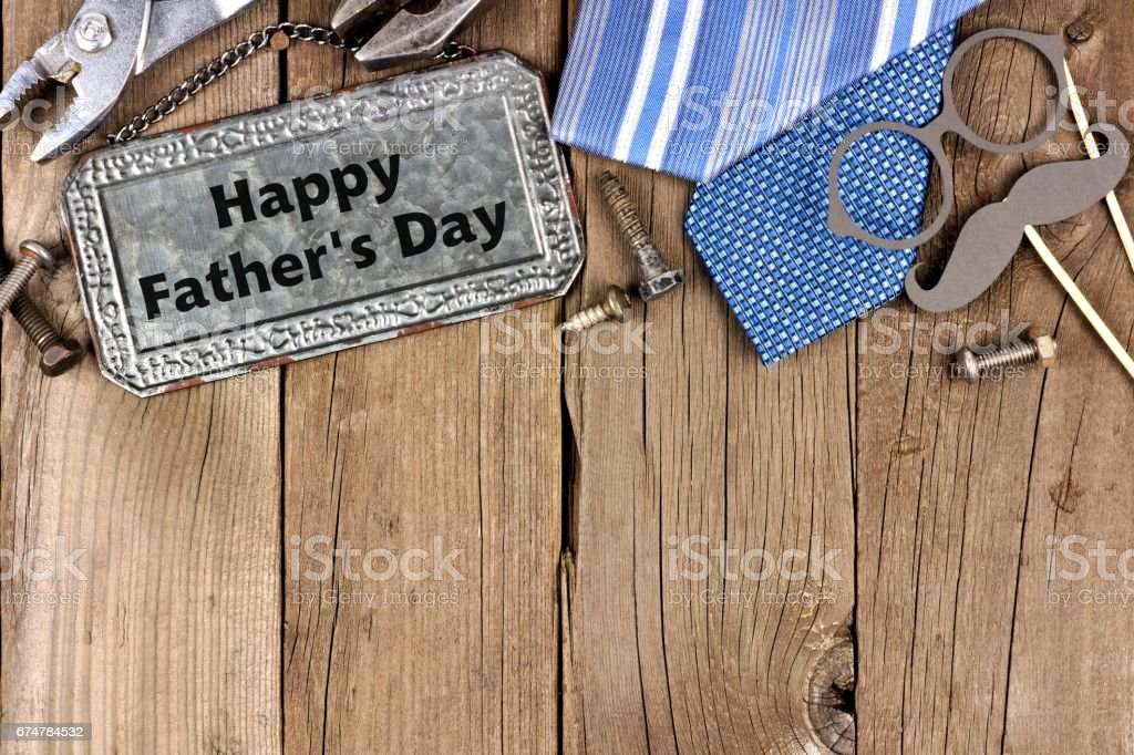 Happy Fathers Day metal sign with top border on wood stock photo