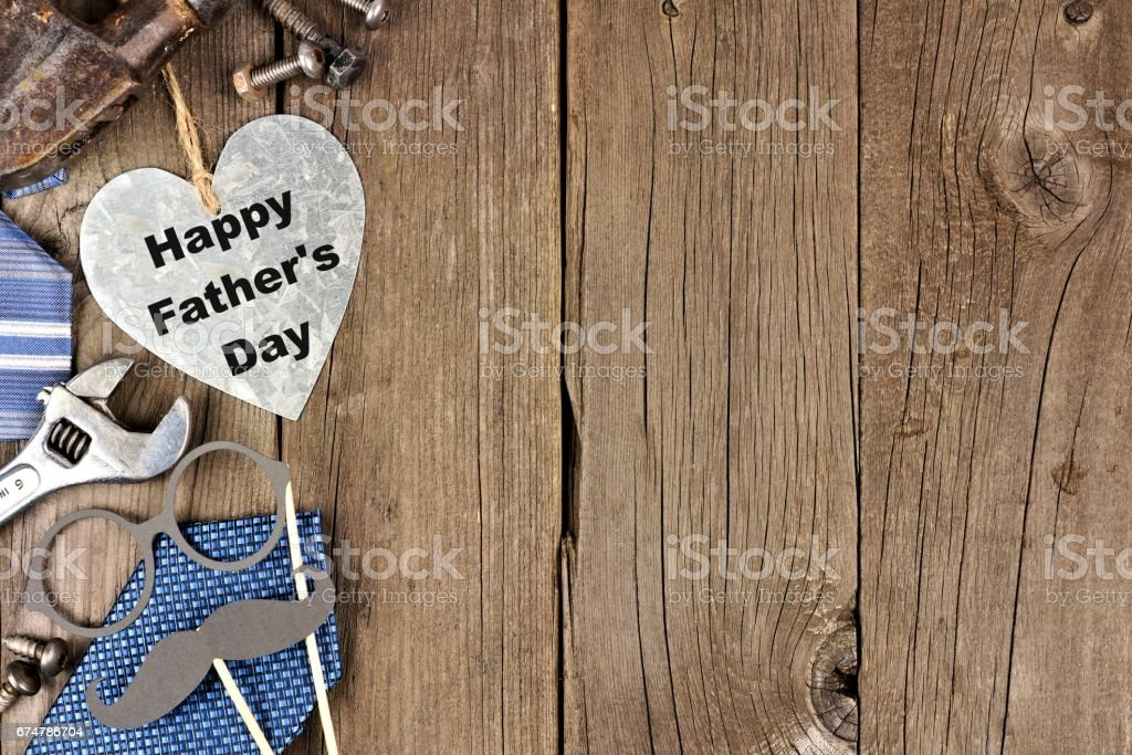 Happy Fathers Day metallic heart with side border on wood stock photo