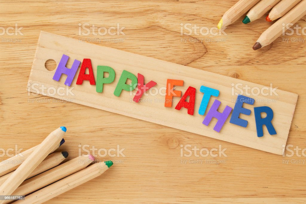 Happy fathers day  on wooden background - Foto stock royalty-free di Amore