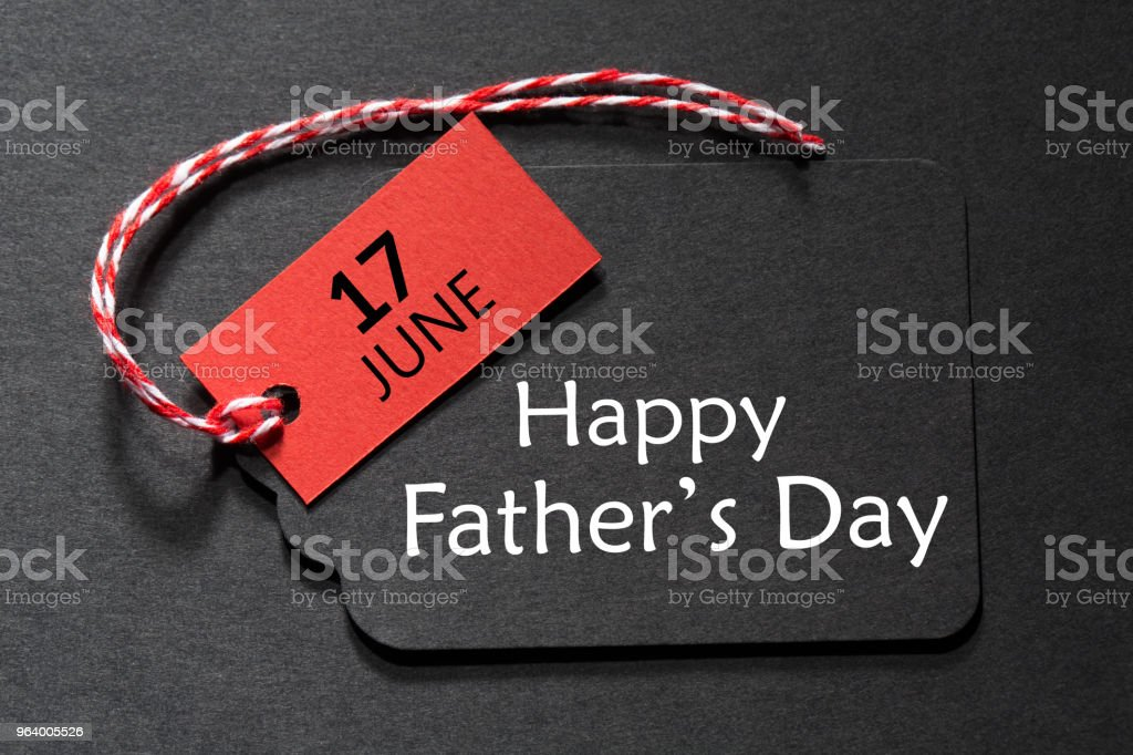Happy Father's Day text on a black tag stock photo