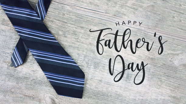 happy father's day text with striped tie over wood background - fathers day stock photos and pictures