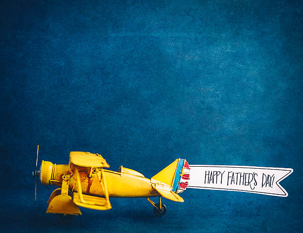 happy father's day! vintage airplane with handmade banner - fathers day stock photos and pictures
