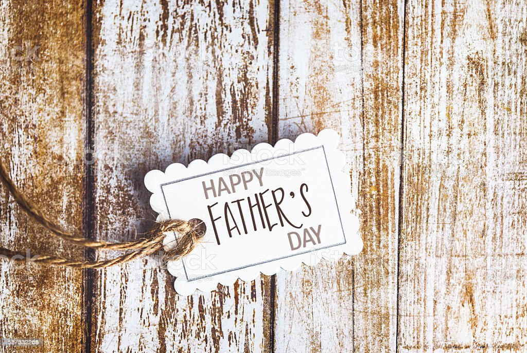 Happy Father's Day wish on gift tag with copy space stock photo