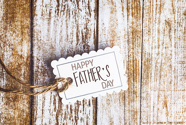 happy father's day wish on gift tag with copy space - fathers day stock photos and pictures