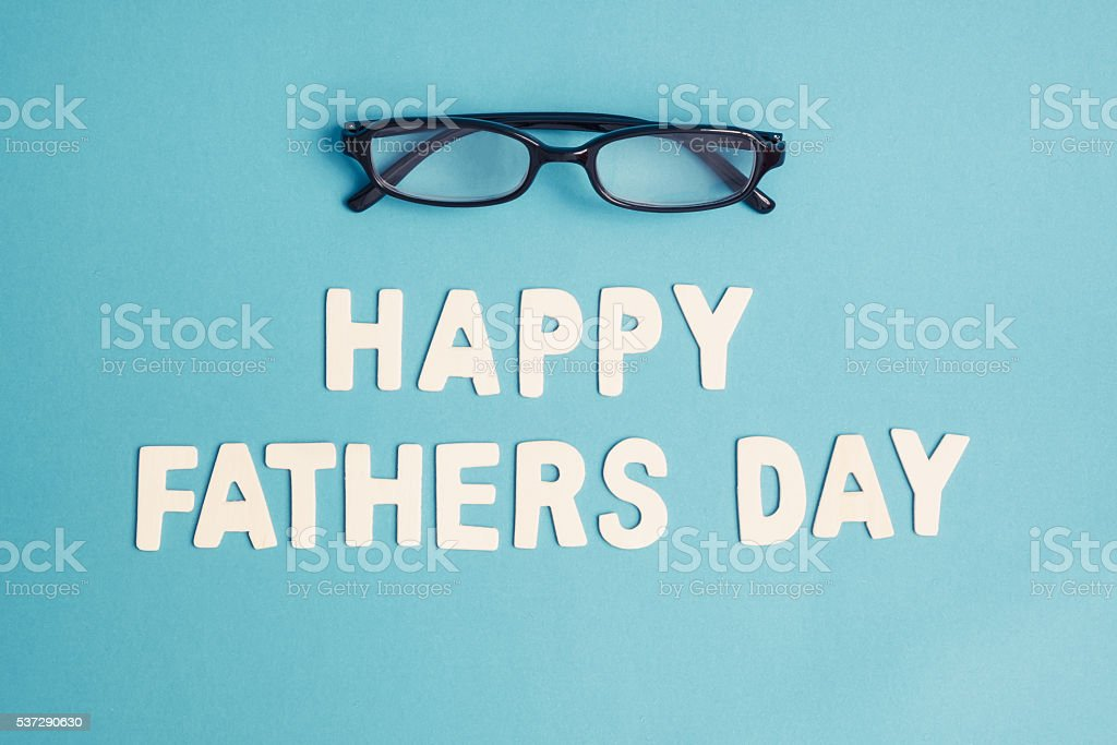 Happy Father's Day with black glasses on blue blackground stock photo