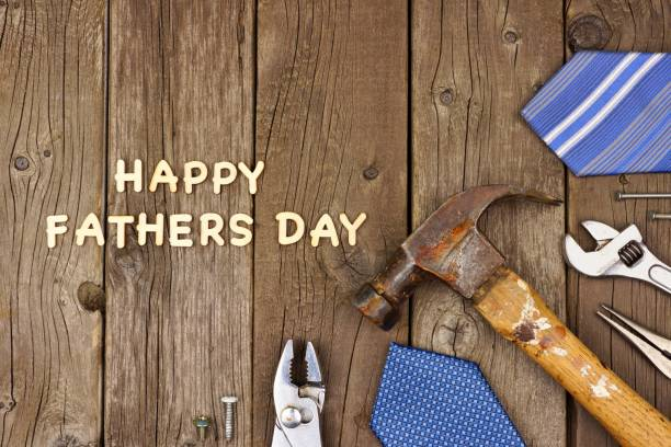 happy fathers day wood letters with tools and ties on rustic wood - fathers day stock photos and pictures
