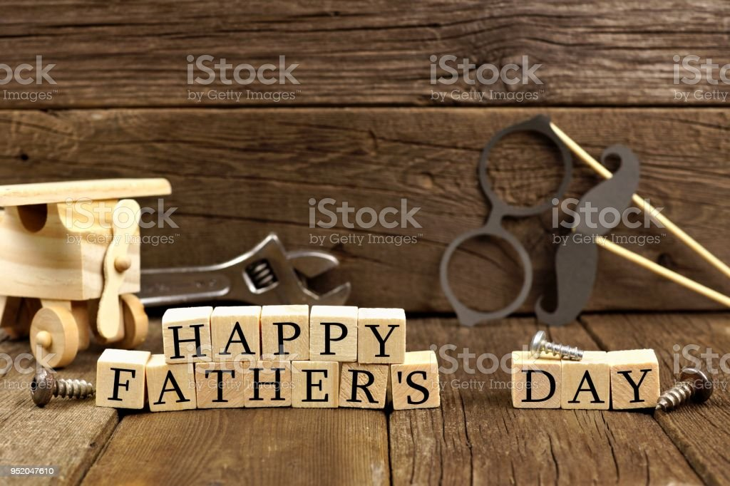 Happy Fathers Day wooden blocks with decor against rustic wood stock photo