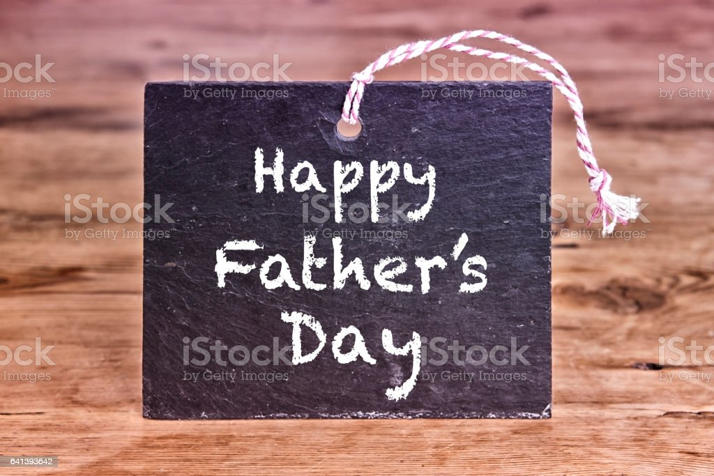 Happy Fathers Day written on chalk board stock photo