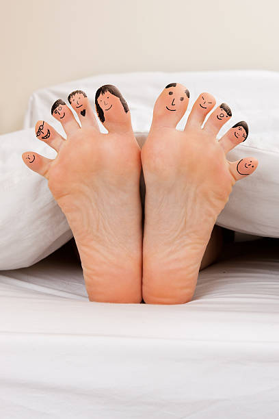 Happy feet Feet with happy face drawings of different characters sole of foot stock pictures, royalty-free photos & images