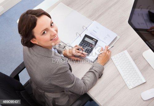 istock Happy Female Accountant 469095431