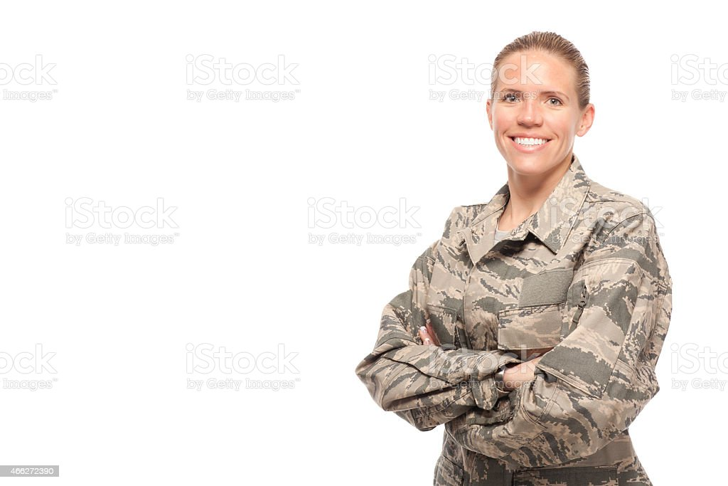 Happy female airman Portrait of happy female airman against white background 2015 Stock Photo