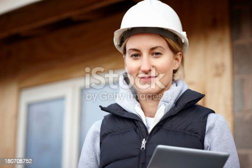 istock Happy female architect with a tablet computer 180708752
