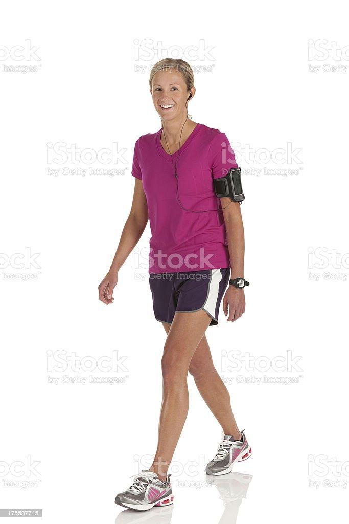 Happy female athlete walking royalty-free stock photo