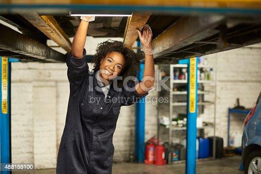 599909112 istock photo happy female auto mechanic 488155100