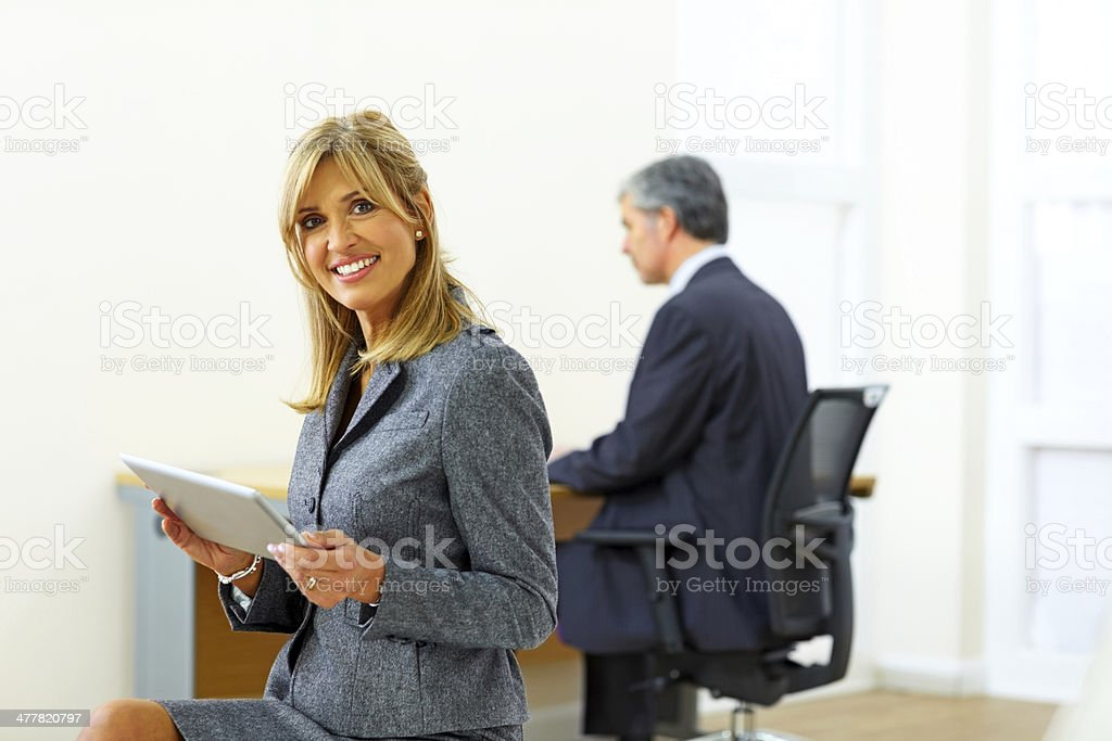 Happy female business executive at office royalty-free stock photo