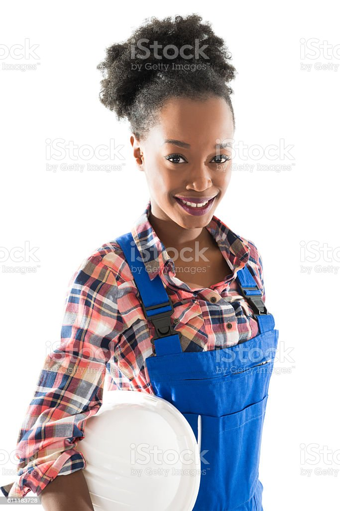 Happy Female Carpenter Standing Arms Crossed stock photo