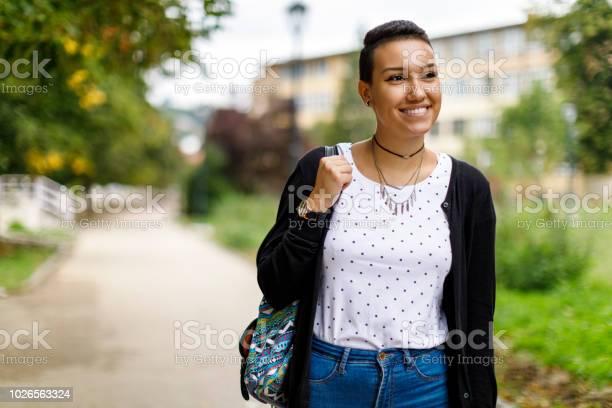 Happy female college student on university campus picture id1026563324?b=1&k=6&m=1026563324&s=612x612&h=uiaav yfjfdaunqslflnnijrxh7al9qkg2spwl2nqf8=