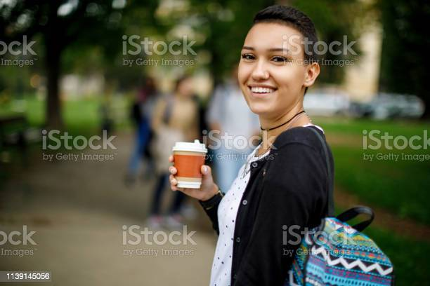 Happy female college student outdoors picture id1139145056?b=1&k=6&m=1139145056&s=612x612&h=lsg5g35v cogc8mflkvnlgedarfobiscpsxnyj8ccky=