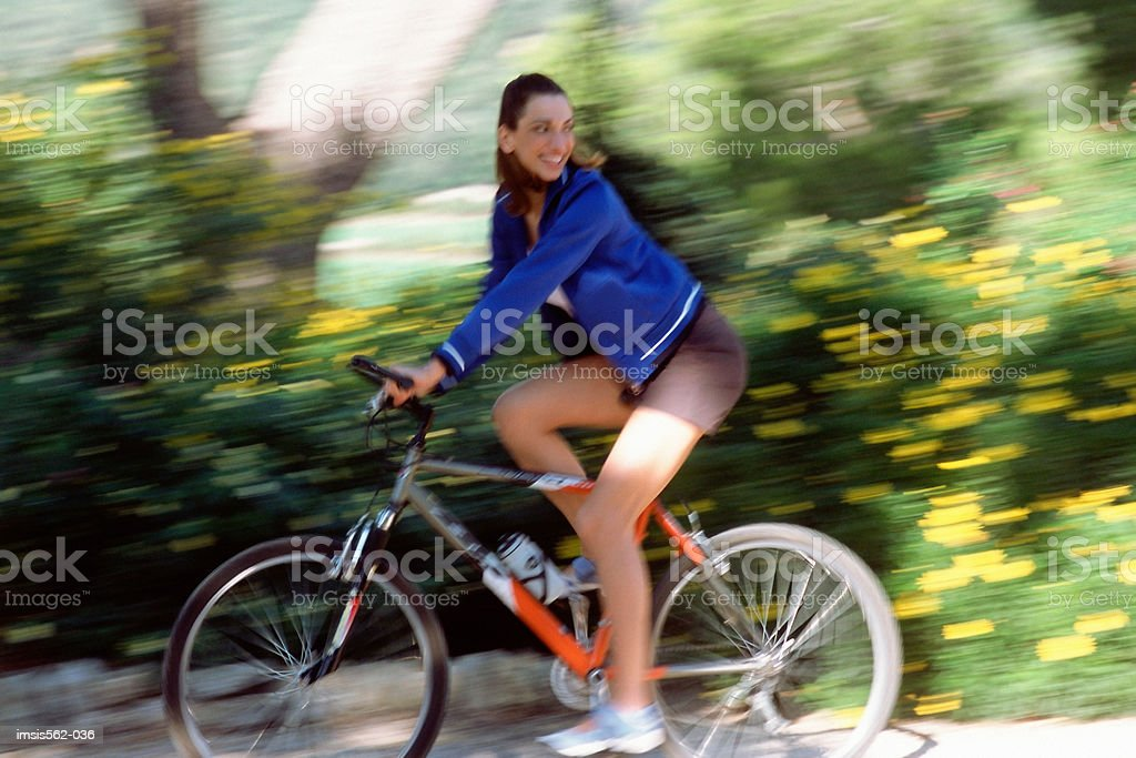 Happy female cyclist royalty free stockfoto