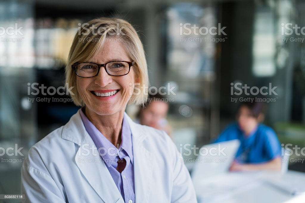 Happy female doctor in hospital stock photo