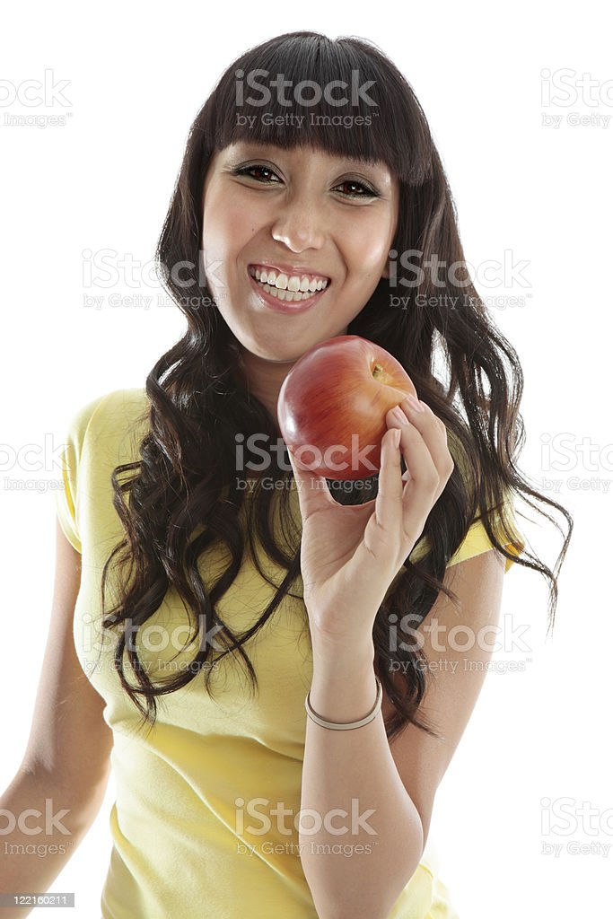 Happy female eating healthy apple royalty-free stock photo