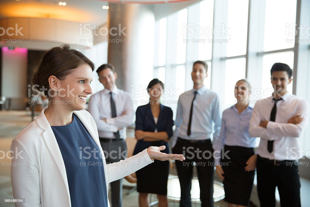 Happy Female Executive Manager with Team stock photo