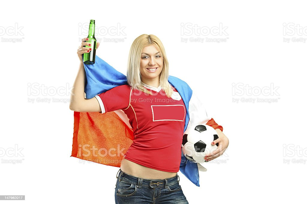 Happy female fan holding a bottle and football royalty-free stock photo