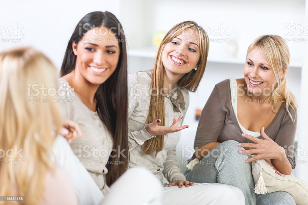 Happy female friends communicating at home. royalty-free stock photo