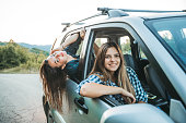 Young happy women having fun on the road. Copy space.