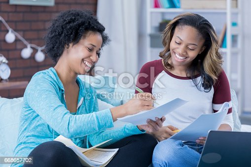 istock Happy female friends study together 668657702