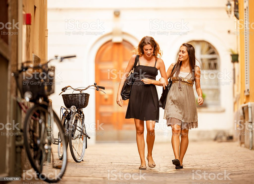 happy female Friends walking in the City royalty-free stock photo