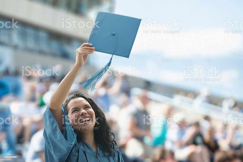 Happy female graduate stock photo