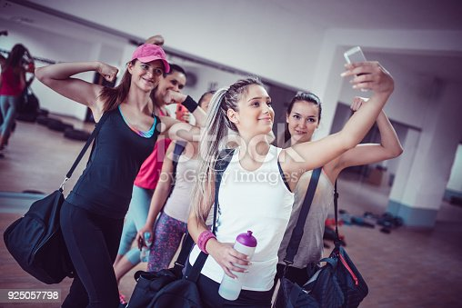 istock Happy Female Group Taking Selfie in Gym after Exercise 925057798