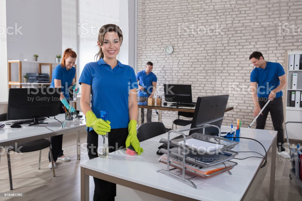Happy Female Janitor In Office stock photo