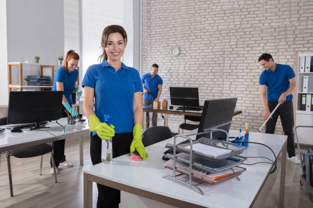 happy female janitor in office - clean stock pictures, royalty-free photos & images