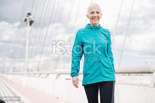 istock Happy female jogger 958918684
