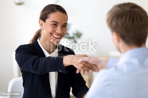 843963182 istock photo Happy female mixed race manager shaking hands with job applicant. 1200214082
