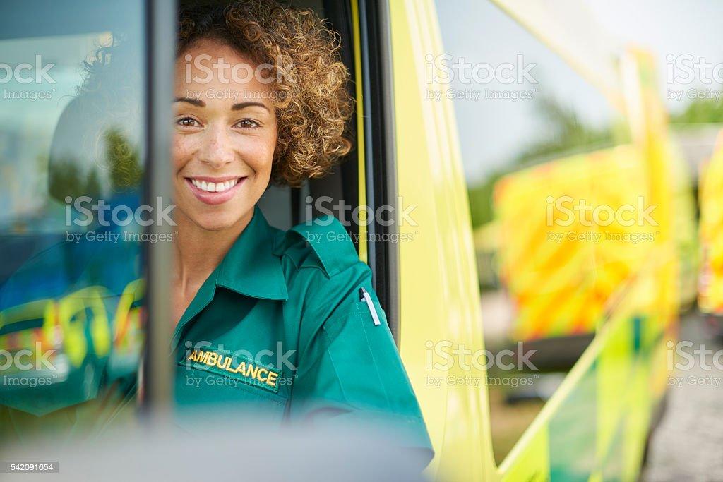 happy female paramedic stock photo