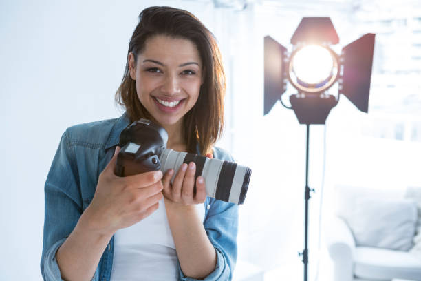 Happy female photographer standing in studio picture id656508826?b=1&k=6&m=656508826&s=612x612&w=0&h=b3xt6foucgrqts4zdzkwg hpgou0tqmoy8wl376irl4=