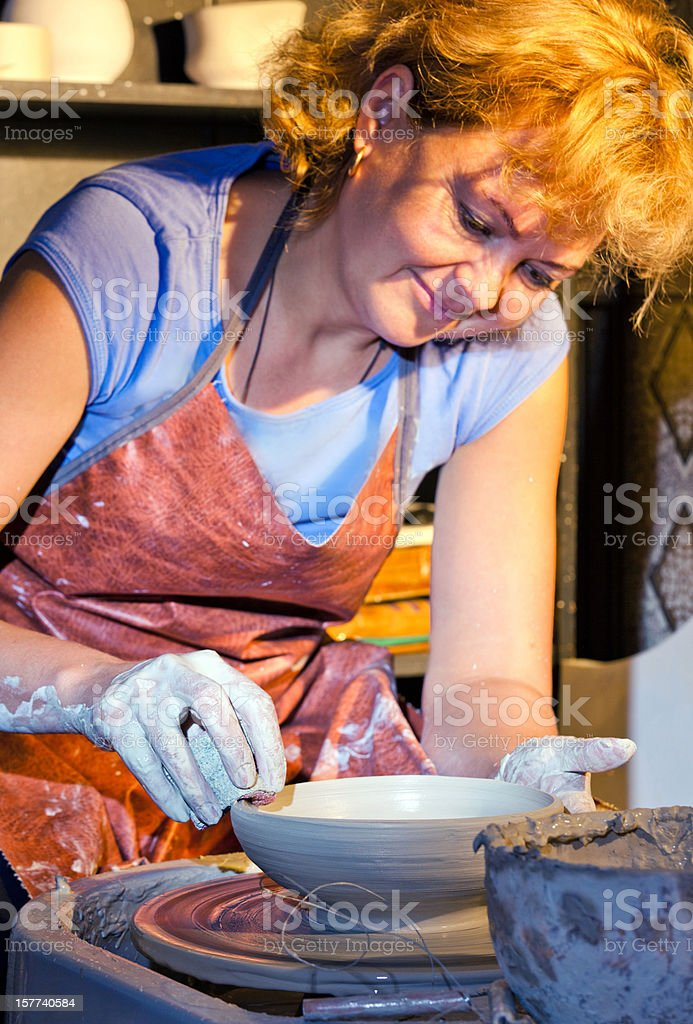 Happy female potter at work royalty-free stock photo