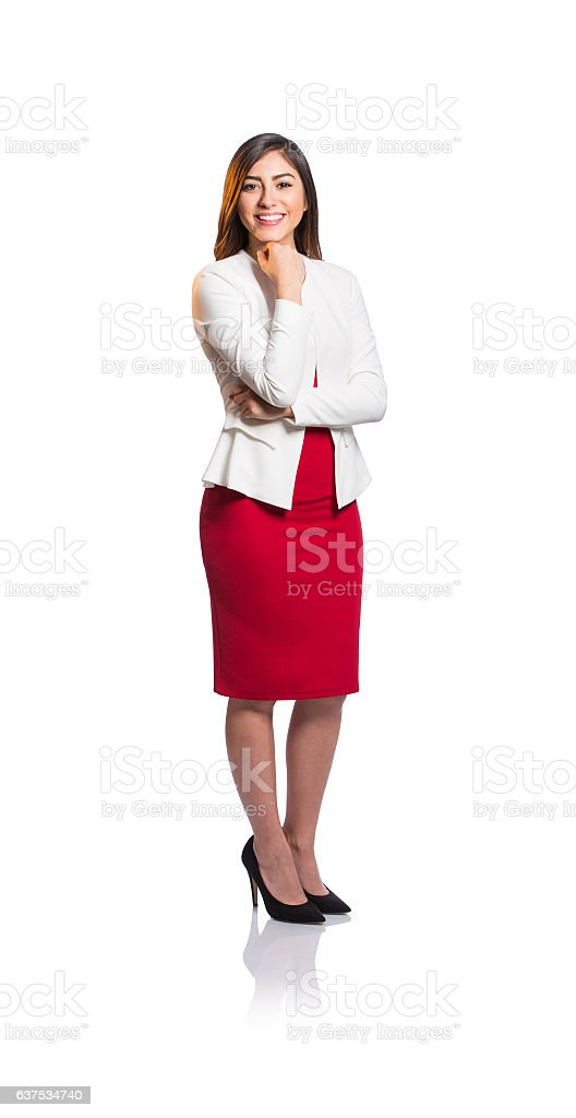 Happy female professional worker standing with hand on chin - foto de stock