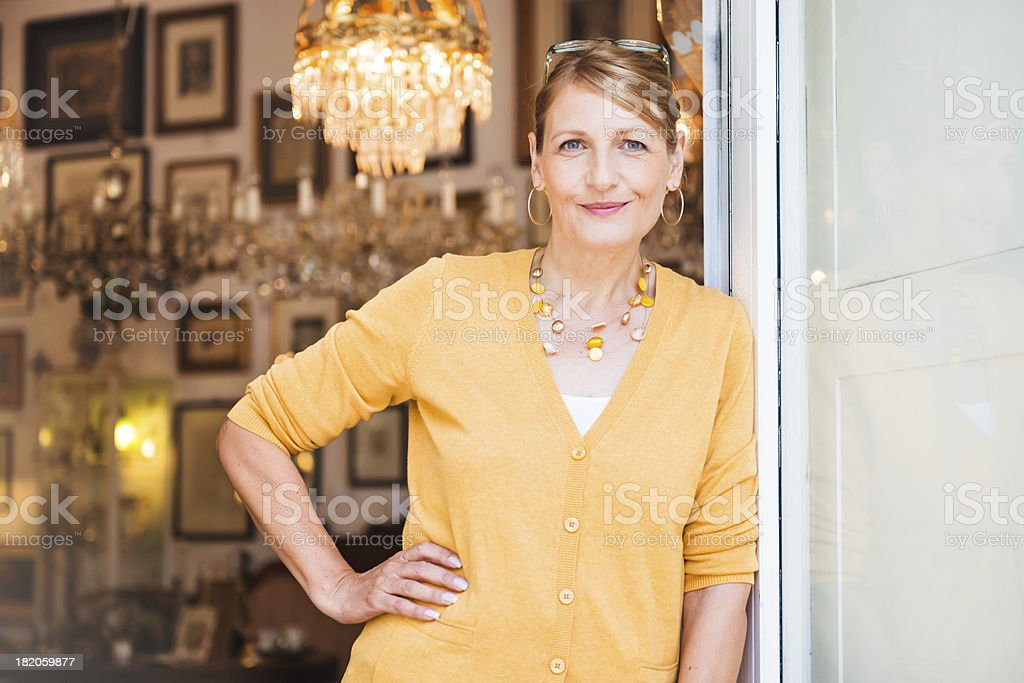Happy Female Shop Owner stock photo
