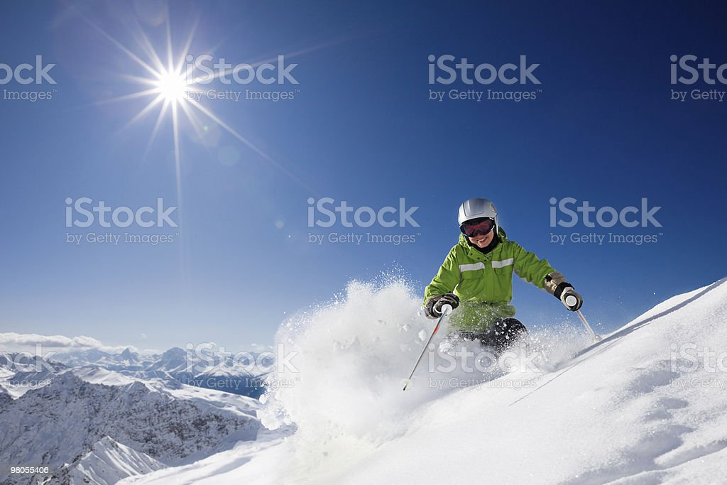 Happy female skier with mountain view stock photo