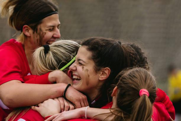 Happy Female Soccer Players Celebrating Goal stock photo