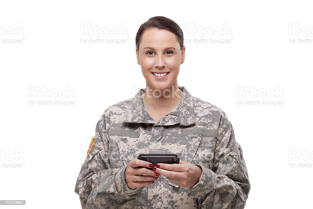 Happy female soldier using mobile phone royalty-free stock photo