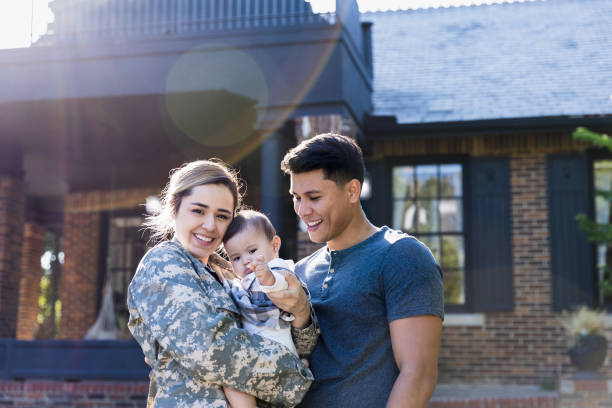Happy female soldier with her family stock photo