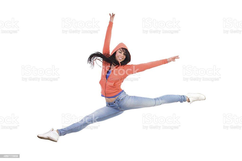 Happy female split jump stock photo