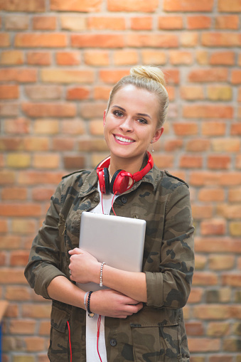 Happy Female Student At School Laughing At Camera Stock Photo - Download Image Now
