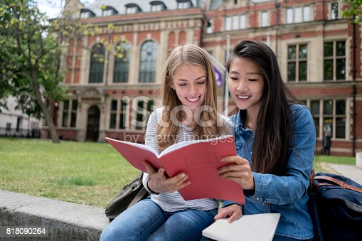istock Happy female students studying outdoors 818090264