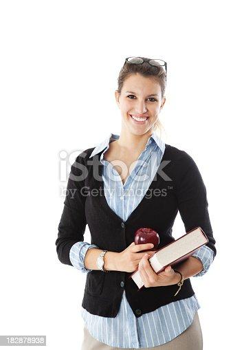 istock Happy Female Teacher Holding Apple and Book 182878938